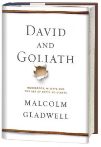"A white book with gold border ""David and Goliath"" by Malcolm Gladwell"