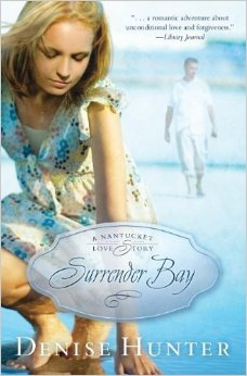 A book cover. A woman bends down to pick something from the ground. A man walking on the beach in the background.